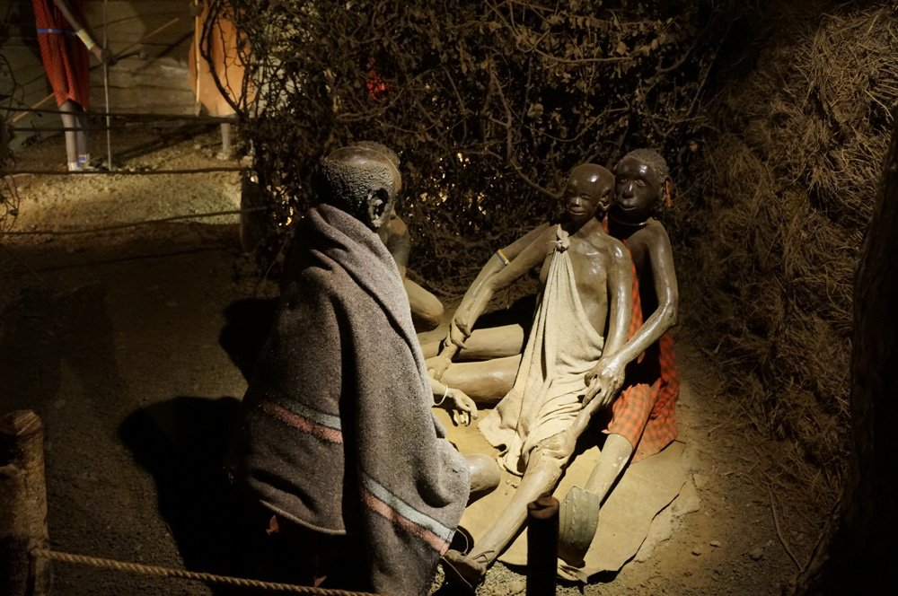 Statue of a circumcision being performed.