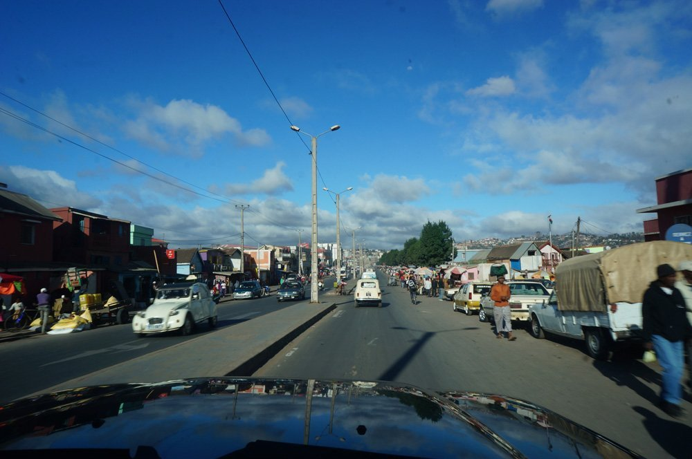 Meandering through Tana's traffic. The little 60s Volkswagen beetle looking car is the main taxi style of the capital.