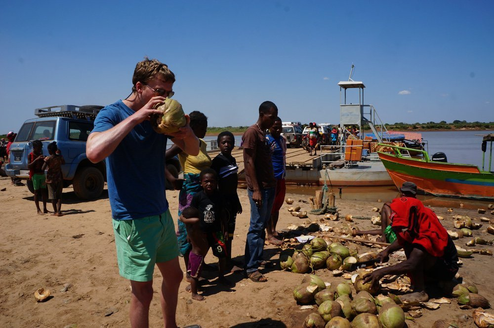 Enjoying some 20 cent coconuts after our long ferry ride.
