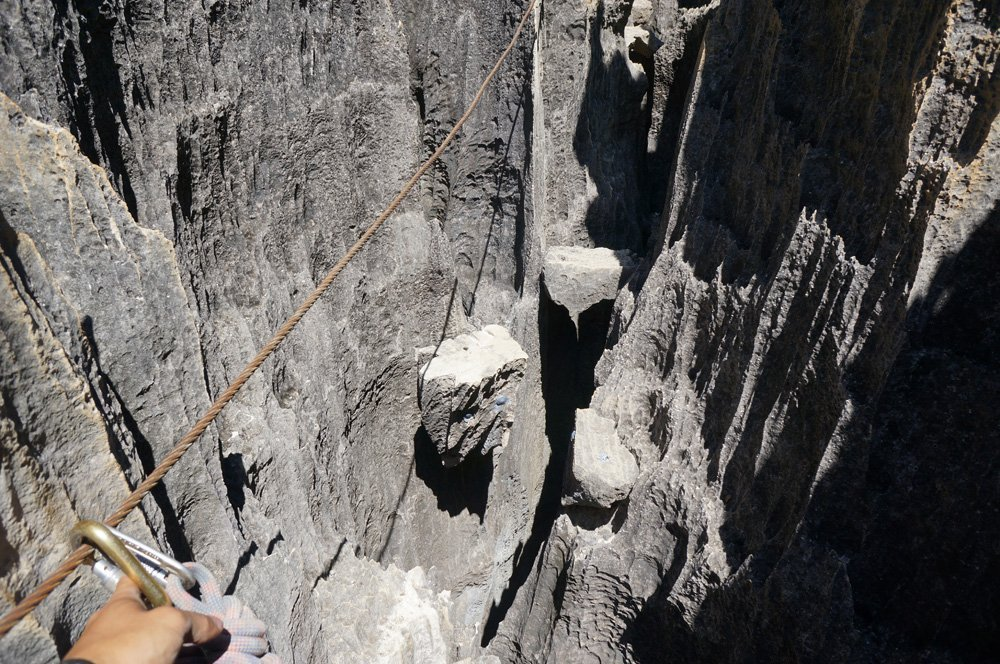 Scaling the side of the rocks. Careful when grabbing onto them, as some are sharp as knives.