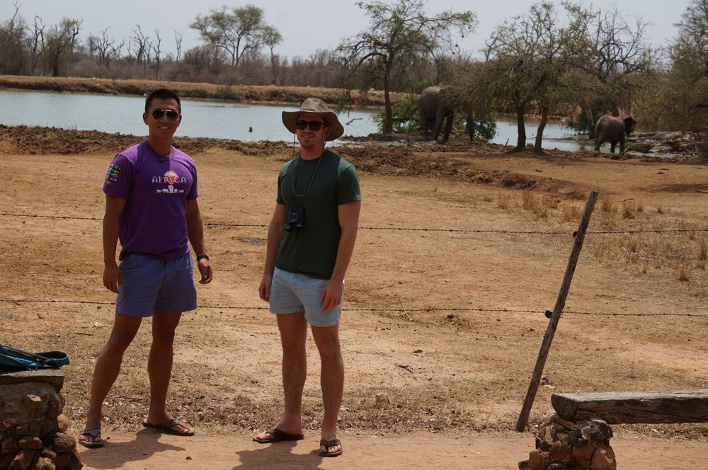 """Getting some selfies taken. Later, we got a bit too close to a bull elephant grazing, thinking the """"electric"""" fences would actually protect us at all, and he ended up charging us. Might have been the scariest moment in my life!"""