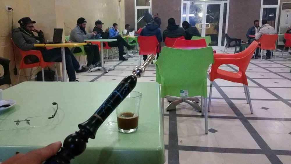 Smoking a shisha with the locals at night.